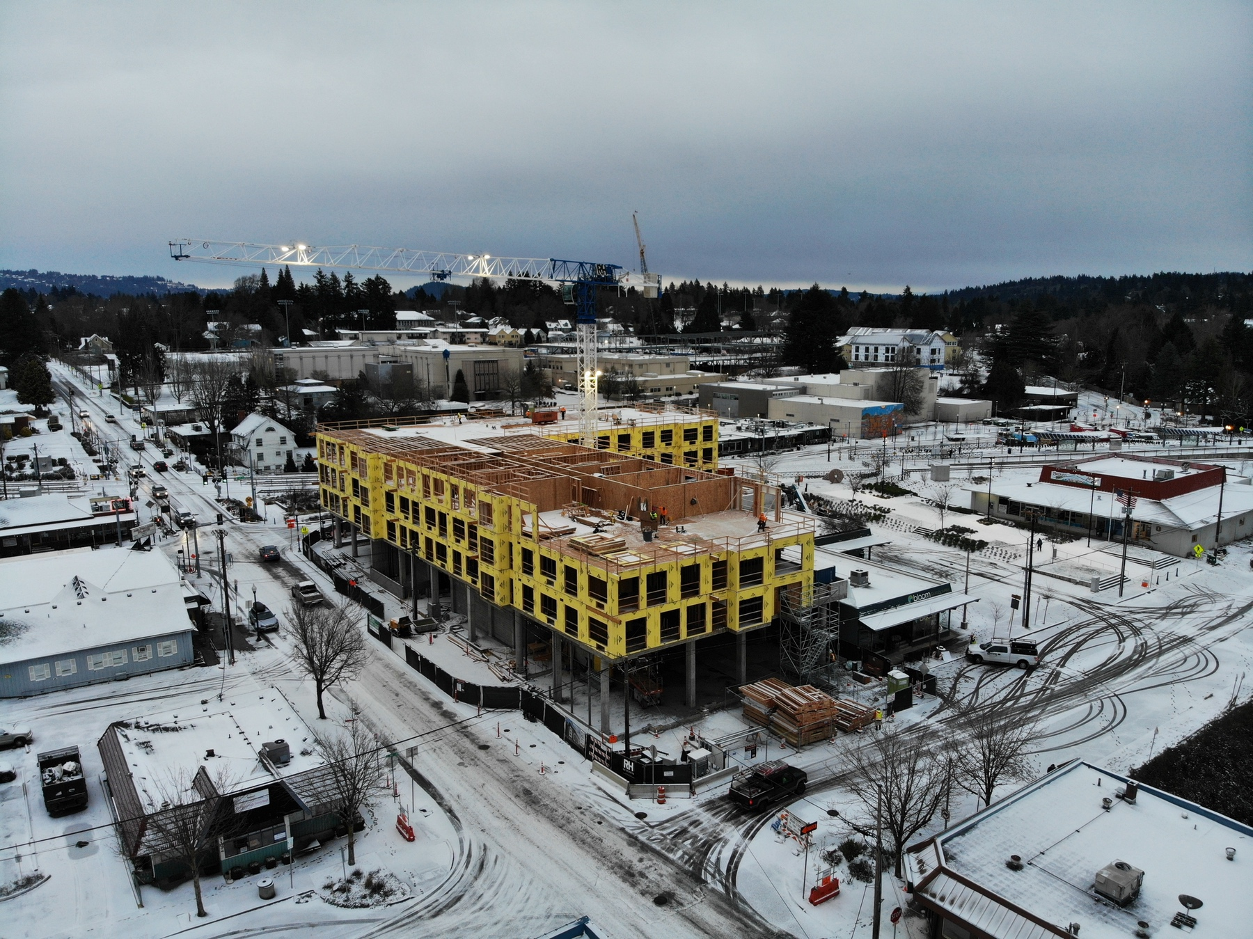 Axletree Apartments: Multifamily Housing built by R&H Construction jobsite in snow drone view