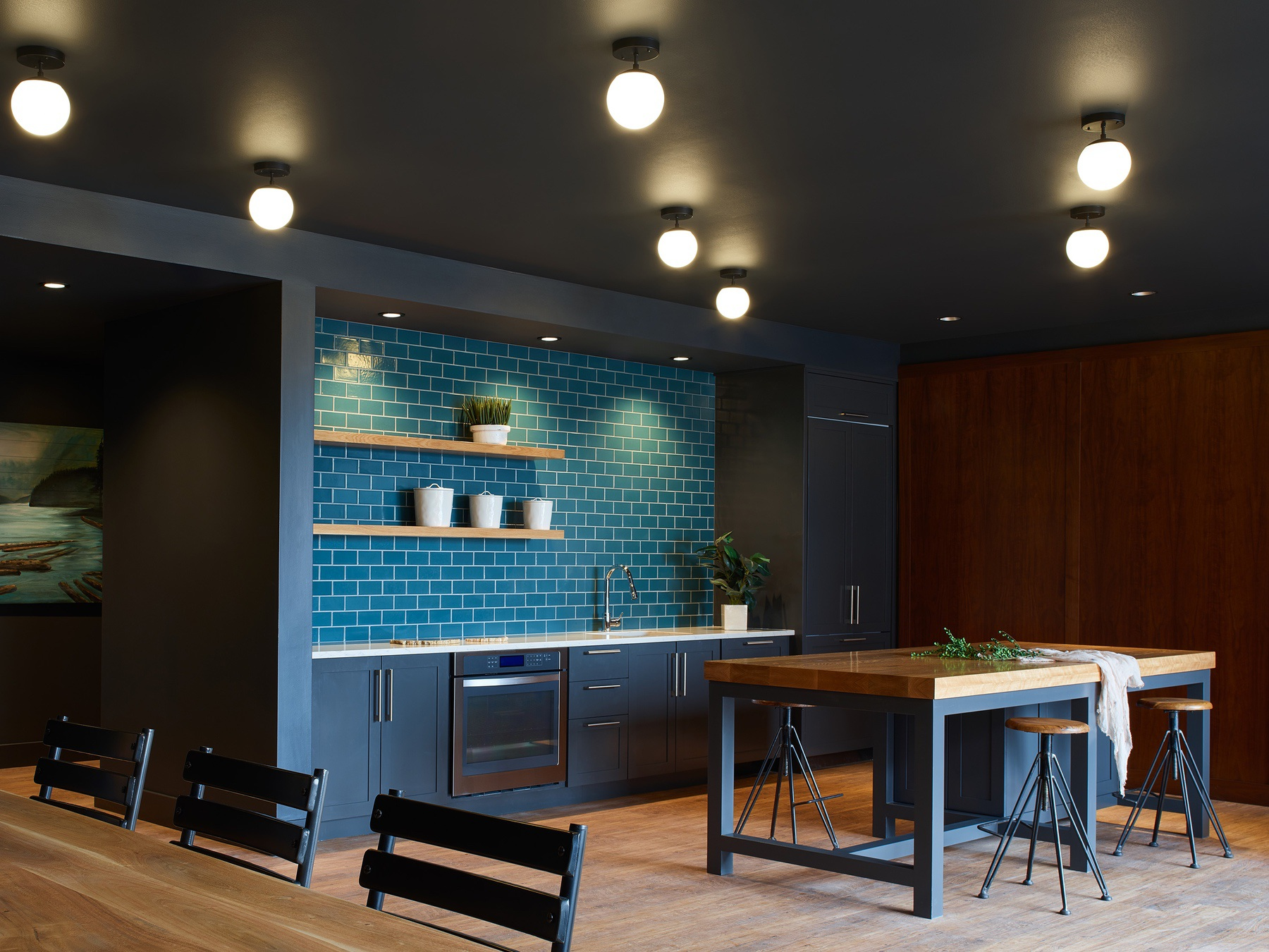 The Union at St. Johns Multifamily Housing interior common area with kitchen view and tile accent wall
